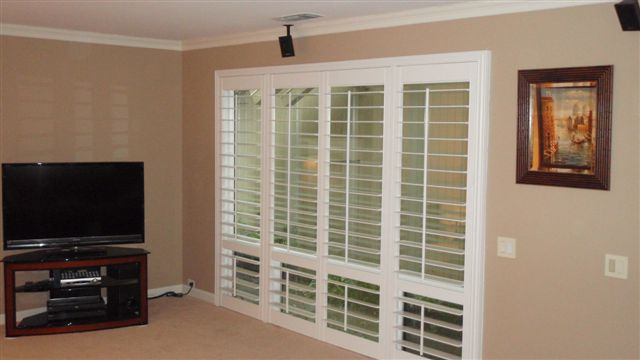 Shutters designed French door-style lend elegance and light to this TV room, while enabling you to control distracting glare.