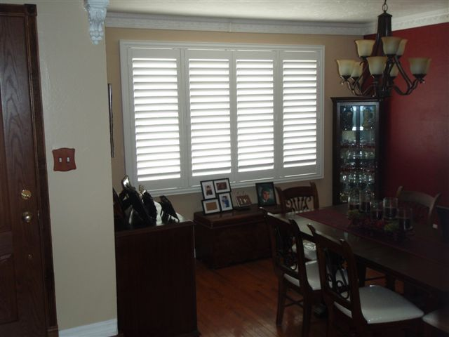 The elegant simplicity of shutters coordinated with crown molding beautifully frame this dining room.