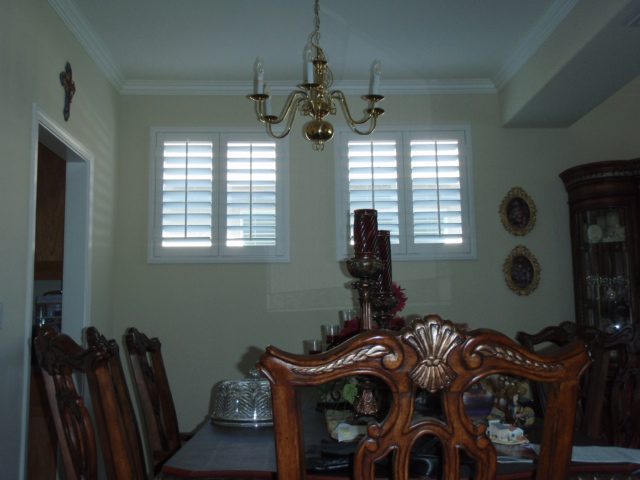 Popular 3 ½ inch louvers bring plenty of light into this dining room.